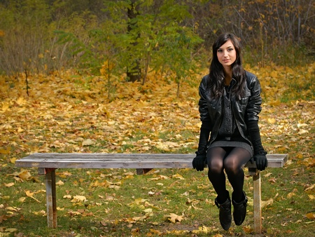 pretty girl alone in the park photo
