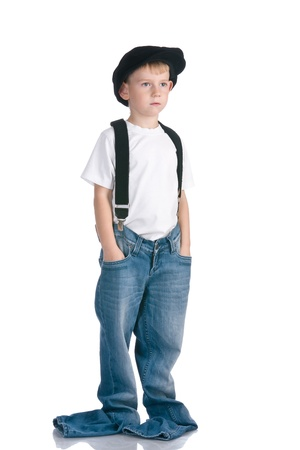 rascal: Kid in cap and too long jeans Stock Photo