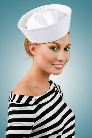 Amazing smiling young girl in sailors cap