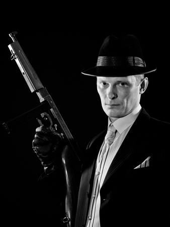 Man like a chicago gangster with Thompson submachine gun photo