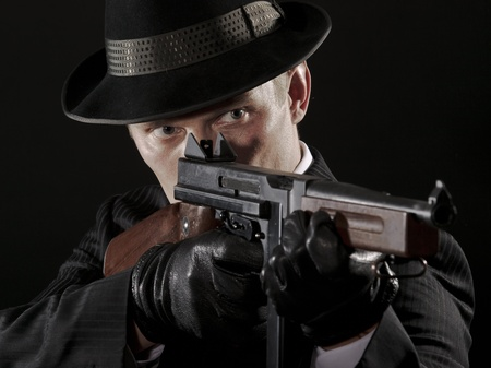 Man aims at Thompson submachine gun photo