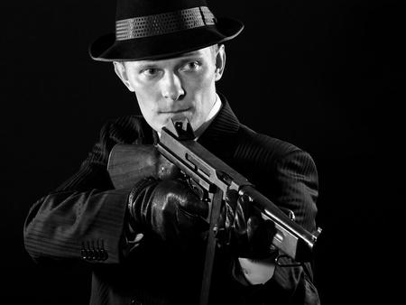 Man keeps a Thompson submachine gun