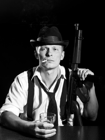 Man like a chicago gangster posing with Thompson submachine gun Stock Photo