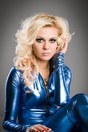 young beautiful lady dressed into the blue latex suit photo