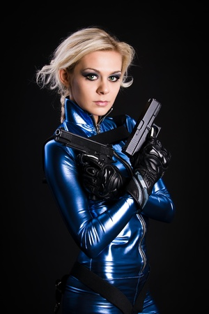 young lady with two guns Stock Photo - 8785452