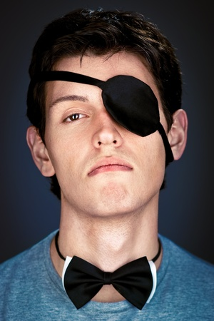 arrogant young man in the piratical eye-band and bow tie Stock Photo - 8785585