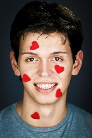 young smiling man with some small hearts on his face Stock Photo - 8785421