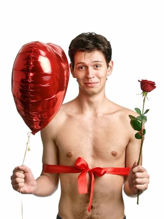 young handsome man with big heart and red rose like a present photo