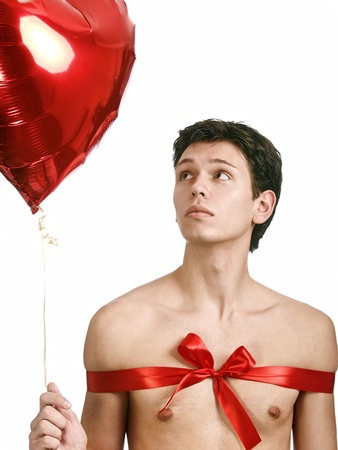 young handsome man with big heart like a present Stock Photo - 8785926