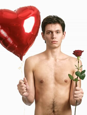 young handsome man with big heart and red rose photo
