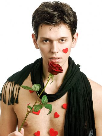 young man with black scarf and red rose photo