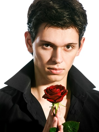 portrait  of young handsome man with red rose photo