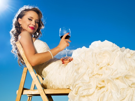 congeniality: beautiful bride in front of the blue sky