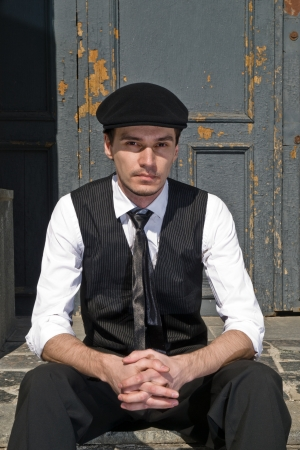 young man in black cap in vintage style
