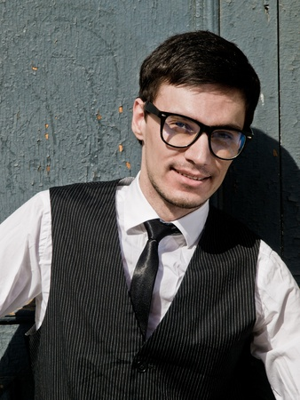 attractive young man in elegant eyeglass in vintage style