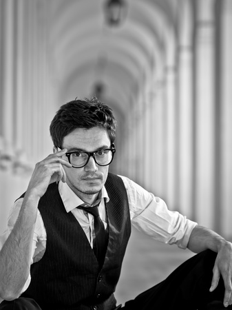 attractive young man in elegant eyeglass in bw retro style Stock Photo