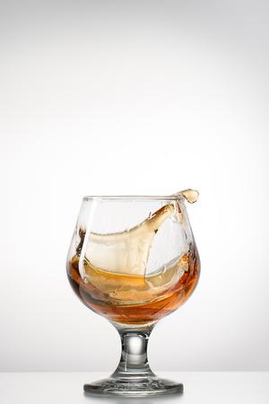 Staing splahing glass  on light background