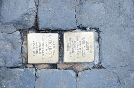 deported: Stolperstein in Rome. Two cobblestones that remeber Angelo Tagliacozzo and Angelo Limentani, two Jews deported in Auschwitz during the second world war. Stolperstein are an initiative of the German artist Gunter Demnig