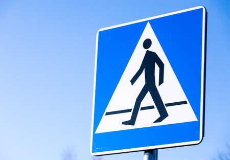 pedestrian: Pedestrian crossing road sign.