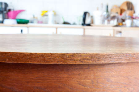 dining room interior: Old rustic table with vintage kitchen defocused background.