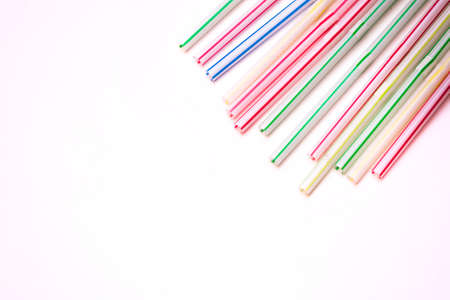 red straw: Plastic straws on a white background.