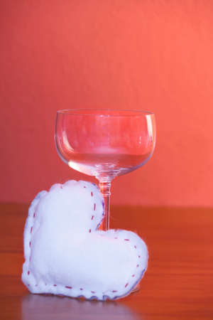 affections: Valentines Day - white heart and wine glass. Stock Photo