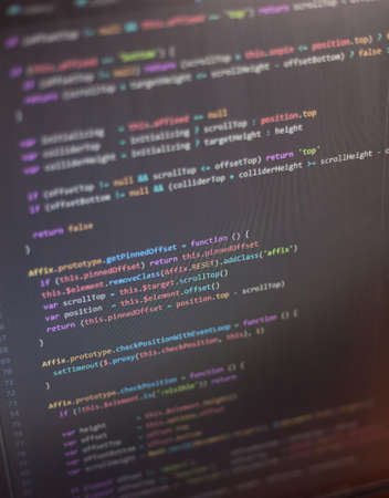 java script: Colorful programming php and html source code on a monitor written by a young programmer. Stock Photo
