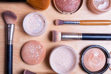 blush: Face makeup cosmetics on a light wooden floor - brush, powder, blush, foundation. Stock Photo