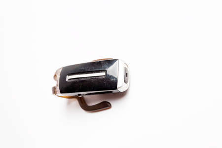 obsolete: Vintage obsolete scratched bluetooth headset isolated white.