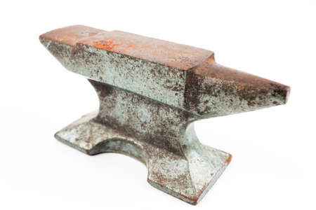 ironwork: Old rusty rugged anvil foundry isolated white background.
