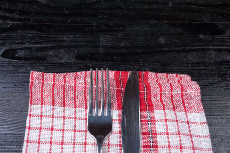 red cloth: Retro old vintage cutlery knife fork natural wooden background kitchen red cloth Stock Photo