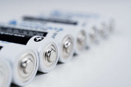 AA or R6 batteries in a row. Shallow depth of field. Battery power concept.