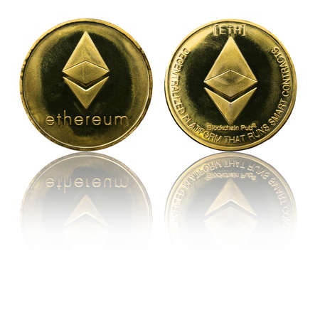Physical Ethereum gold coin (ETH) isolated on white background with reflection. Cryptocurrency. Obverse and reverse sides.