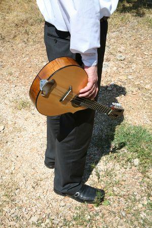 Man with mandolin close up