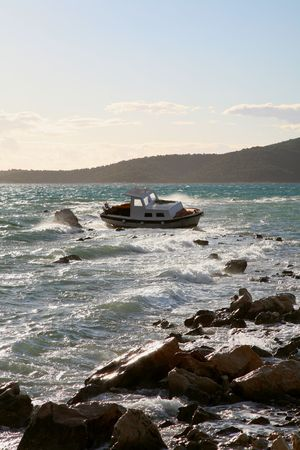 Photo of the  boat stranded on rocks