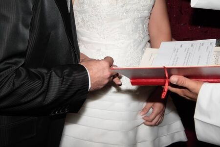 action to put the rings and give consent on a wedding photo