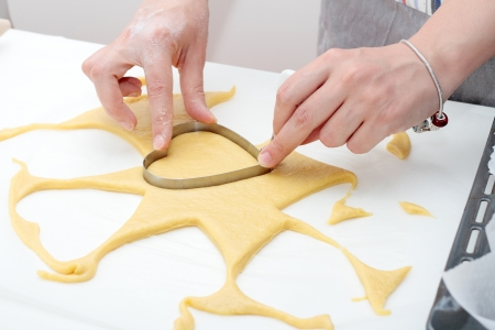 making cookies in the shape of a heart of the earth made handmade with natural ingredients photo