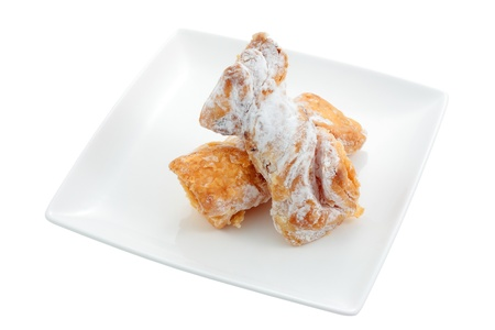 fillers: dish of candy made with puff pastry and sugar cream fillings called bones of saints cut off and isolated