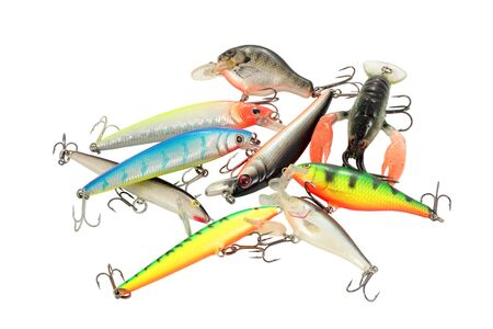 group of lures imitations of fish and crabs of all colors for the cut and isolated fishing photo