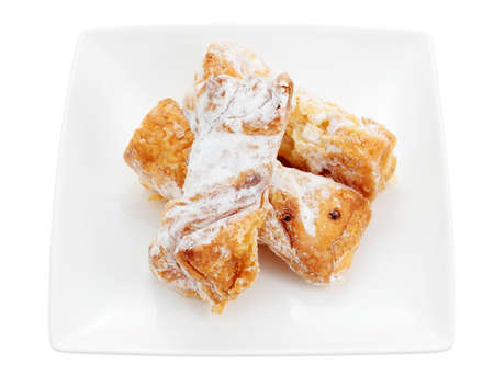 fillers: dish of sweet puff pastry filled with cream cut and isolated