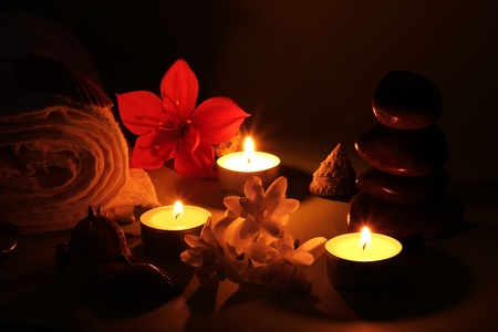 zen spa: objects for relaxation and spa romantic illuminated only by candlelight Stock Photo