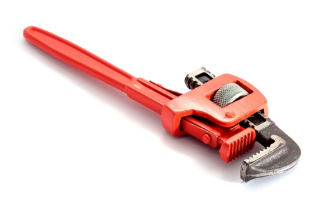fix jaw: adjustable spanner colored red for plumbing isolated on fund in horizontal Stock Photo