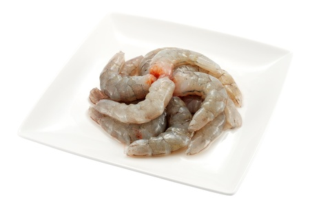 plate peeled prawn tails ready to cook and isolated Stock Photo