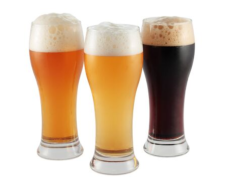 vessels with three different black blond beers and toast and isolated photo