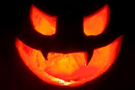 terrifying face made hallowen pumpkin with candle inside illuminating dark background Stock Photo - 16255638