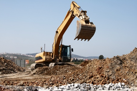 propelled: Propelled large excavator earthmoving working outdoors