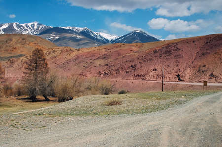 Road, red mountains and blue skies photo