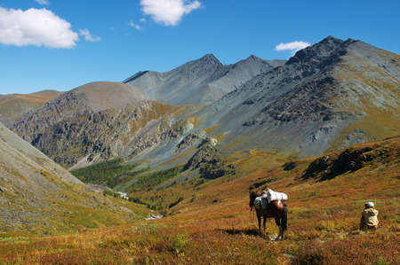 Men, horse and mountains. Altay photo