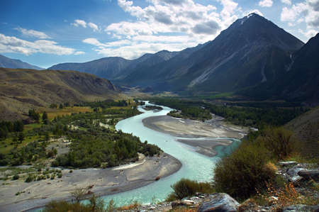 altay: turquoise river, mountains and skies. Altay Stock Photo