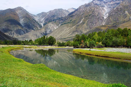 reverberation: turquoise river and mountains, Altay